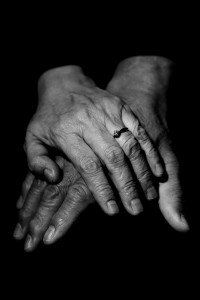 Hands of older couple